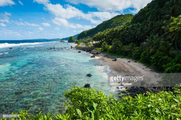 rocky beach on the east coast of tutuila island, american samoa, south pacific - samoa stock pictures, royalty-free photos & images