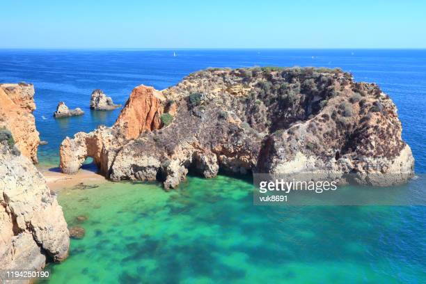 rocky beach - albufeira stock pictures, royalty-free photos & images