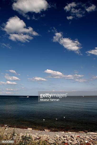 rocky beach sky - mizanur rahman stock pictures, royalty-free photos & images
