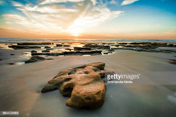 rocky beach sunrise - st. augustine florida stock photos and pictures