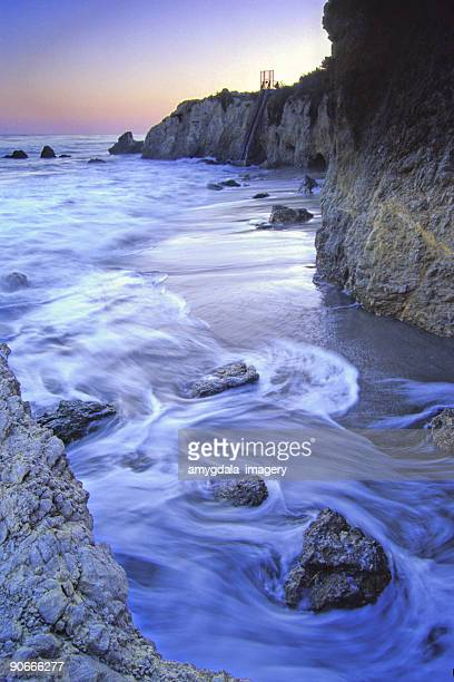rocky beach sunset - malibu beach stock pictures, royalty-free photos & images