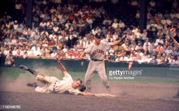 Rocky Bridges of the Detroit Tigers is caught stealing second base as shortstop Woodie Held of the Cleveland Indians tags him out during the second...