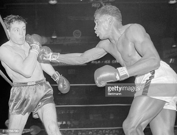 Rocky Castellani, of Cleveland, seeks to ward off a right thrown by Holly Mims, of Washington, D.C., in the second round of a twelve round...