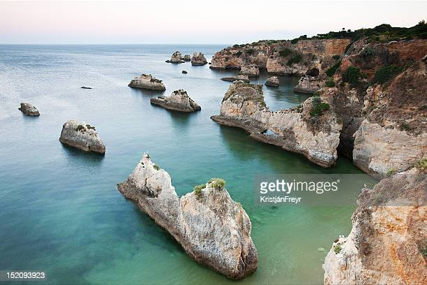 rocky cliff - portimao stock photos and pictures