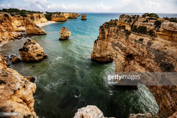 rocky cliffs near portimao in algarve portugal - albufeira stock pictures, royalty-free photos & images