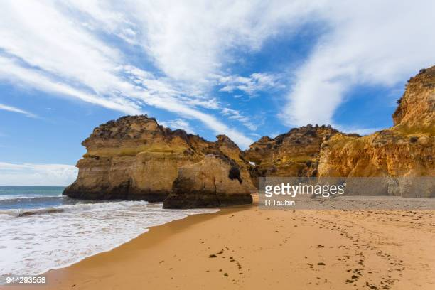 rocky cliffs on the coast - alvor stock pictures, royalty-free photos & images