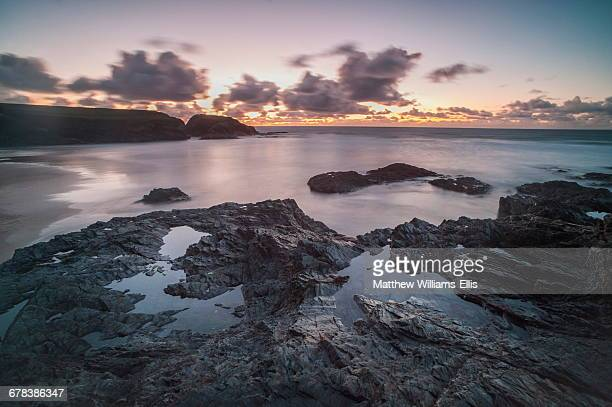 Rocky coast at Treyarnon Bay at sunset, Cornwall, England, United Kingdom, Europe