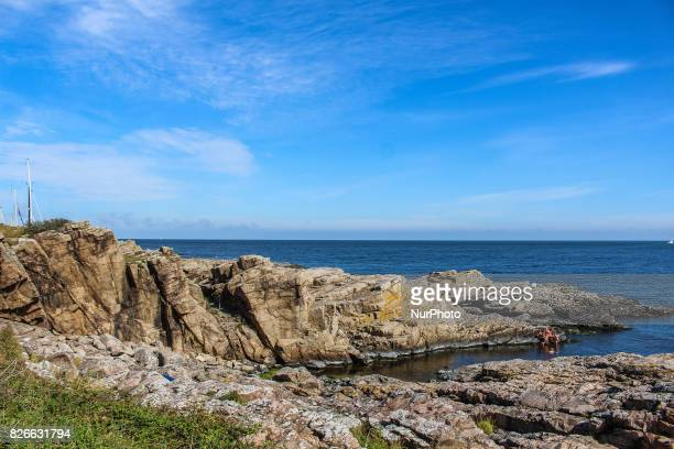 Rocky coast near the Gudhjem is seen on 1 August 2017 in Gudhjem Bornholm Island Denmark