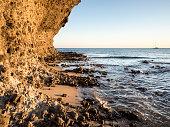 Rocky coast of the Cabo de Gata with formations of volcanic rock of orange color.  Cabo de Gata - Nijar Natural Park, Cala Mosul, Beach, Biosphere Reserve, Almeria,  Andalusia, Spain
