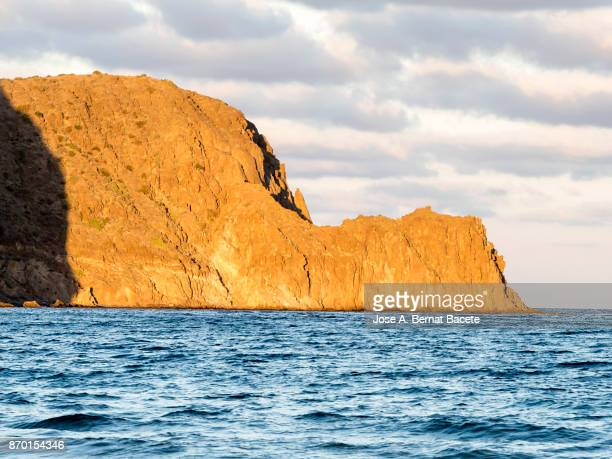 Rocky coast of the Cabo de Gata with mountains and cliffs of volcanic rock on the blue .Cabo de Gata - Nijar Natural Park, punta del barranco negro, Beach, Biosphere Reserve, Almeria,  Andalusia, Spain