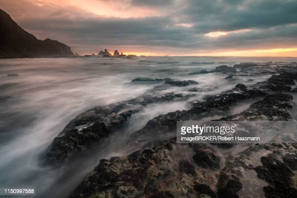 Rocky coast washed by the sea, dramatic light atmosphere, rocks in the sea, Greymouth, West Coast region, South Island, New Zealand
