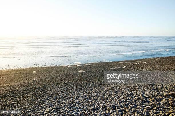 rocky coastline and ocean - rocky coastline stock pictures, royalty-free photos & images