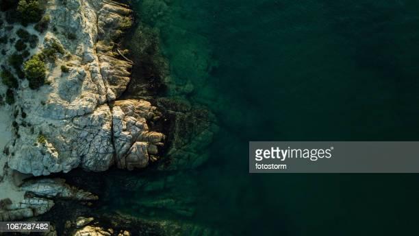 rocky coastline and sea - rocky coastline stock pictures, royalty-free photos & images