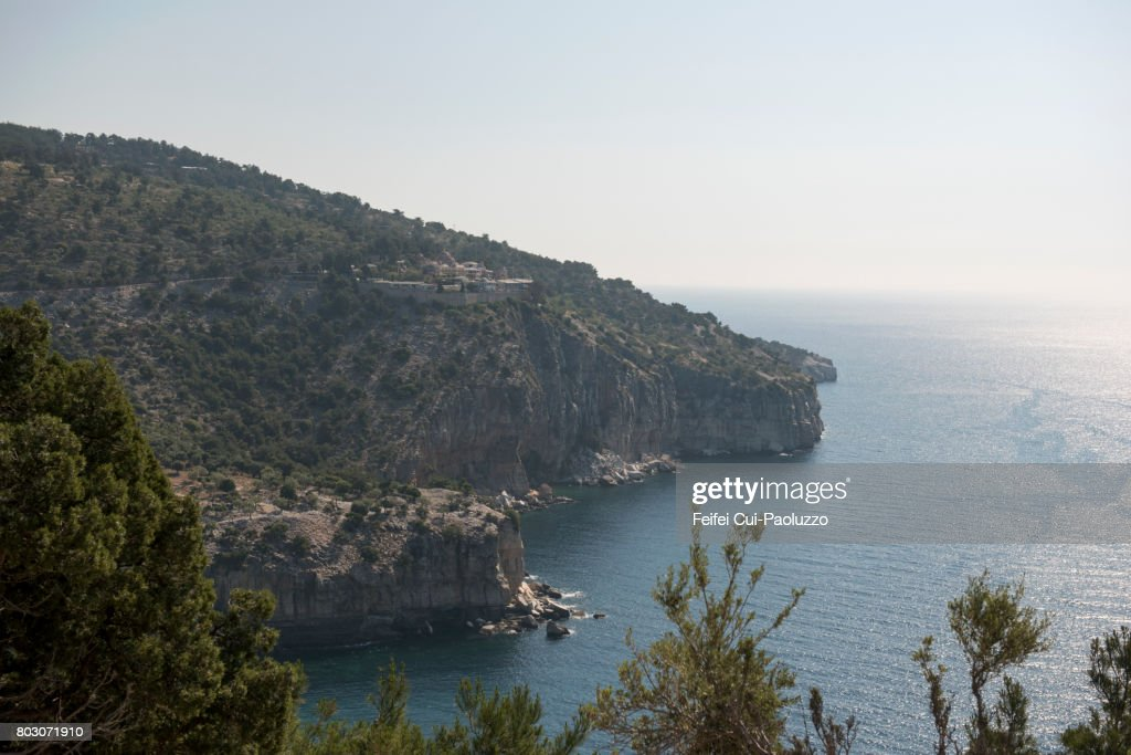 Rocky coastline and view on Monastery of Archangel Thasos, Kavala, East Macedonia and Thrace region, Northern Greece. : Stock Photo