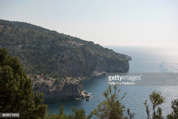 Rocky coastline and view on Monastery of Archangel Thasos, Kavala, East Macedonia and Thrace region, Northern Greece.