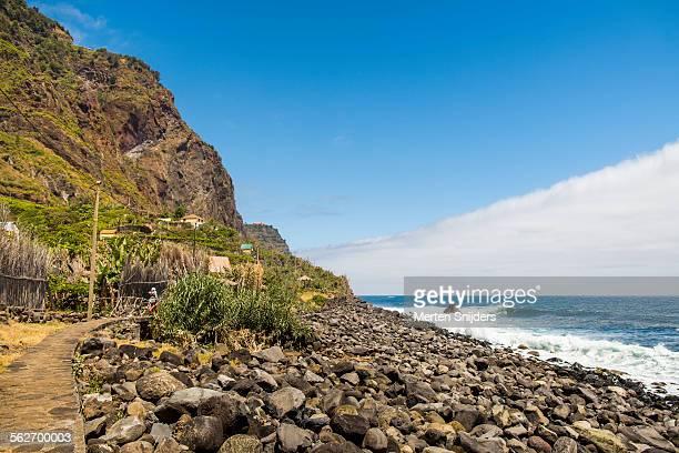 rocky coastline and waves at rocha do navio - merten snijders stockfoto's en -beelden
