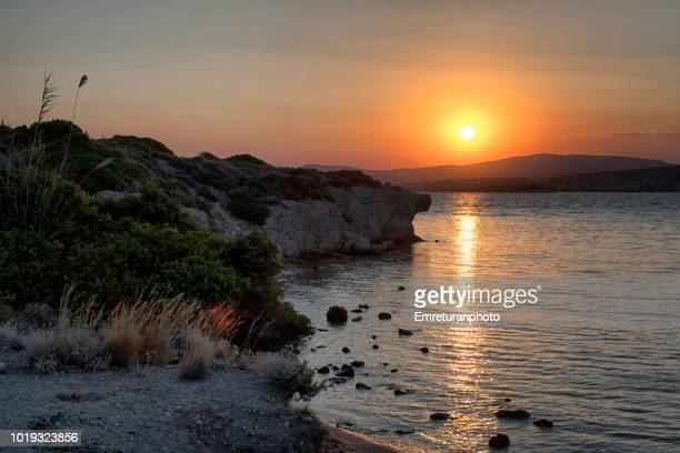 rocky coastline at sifne bay at dawn. - emreturanphoto stock pictures, royalty-free photos & images