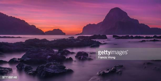 rocky coastline at sunset, el nido, palawan, philippines - palawan stock pictures, royalty-free photos & images