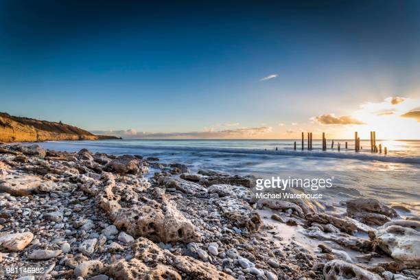 rocky coastline at sunset, port willunga, adelaide, south australia - adelaide stock pictures, royalty-free photos & images