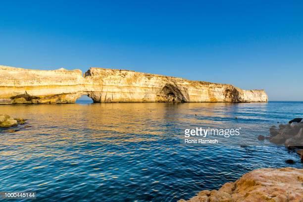 rocky coastline of barr al jissah, oman - barr stock pictures, royalty-free photos & images