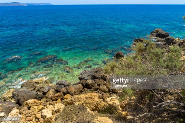 Rocky coastline of Gozo and the beautiful colours of the Mediterranean sea