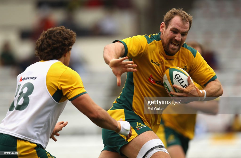Rocky Elsom of the Wallabies fends off Luke Burgess during an Australian Wallabies training session at Ballymore Stadium on August 25, 2011 in Brisbane, Australia.