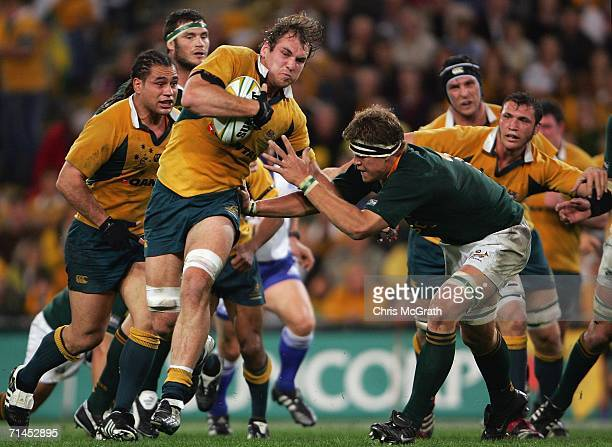 Rocky Elsom of the Wallabies makes a break during the Tri Nations series Mandela plate match between Australia and South Africa played at Suncorp...