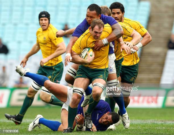 Rocky Elsom of the Wallabies runs the ball during the International Test match between the Australian Wallabies and Samoa at ANZ Stadium on July 17...