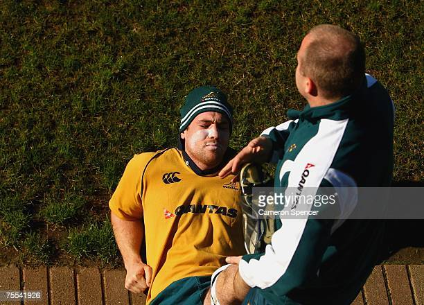 Rocky Elsom of the Wallabies stretches during an Australian Wallabies training session at Dliworth Senior School July 19 2007 in Auckland New Zealand