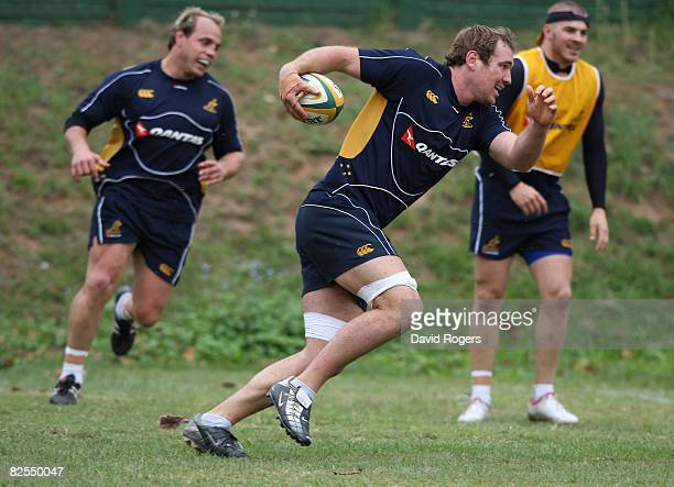 Rocky Elsom runs with the ball during the Australian Wallabies training session held at Crusaders on August 26 2008 in Durban South Africa