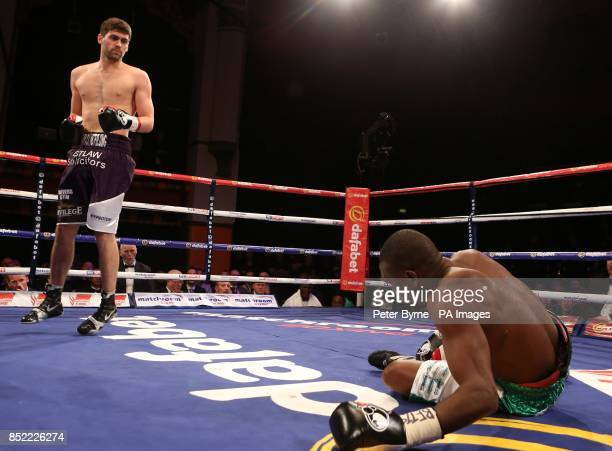 Rocky Fielding knocks down Mohammed Akrong during the vacant Commonwealth Supermiddleweight Title bout at Liverpool Olympia Liverpool