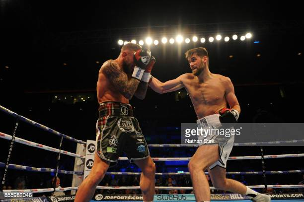 Rocky Fielding lands a shot on David Brophy during the Battle on the Mersey SuperSuperBritish and Commonwealth SuperMiddleweight Championships fight...