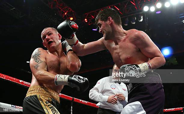 Rocky Fielding of Liverpool hits Wayne Reed of Sheffield with a left hand during the English SuperMiddleweight title fight at the Echo Arena on March...