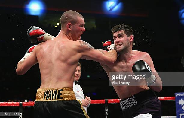 Rocky Fielding of Liverpool hits Wayne Reed of Sheffield with a right hand during the English SuperMiddleweight title fight at the Echo Arena on...