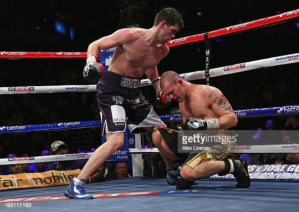 Rocky Fielding of Liverpool knocks down Wayne Reed of Sheffield during the English SuperMiddleweight title fight at the Echo Arena on March 30 2013...
