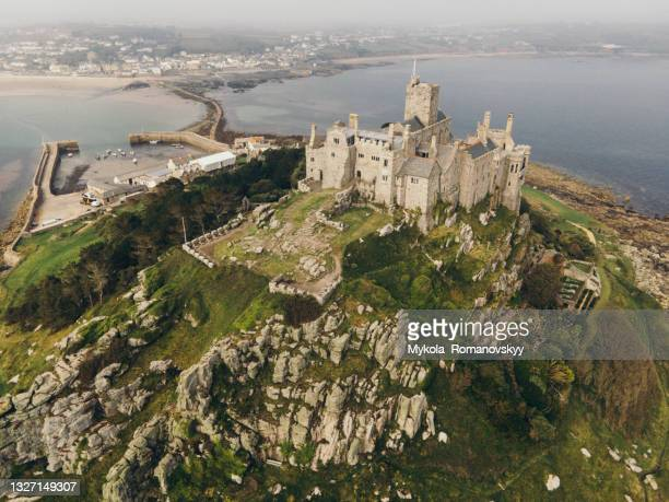 rocky footpath connects st michael mountain with mainland in mount's bay, cornwall, england. june 02, 2021 - st michael's mount stock pictures, royalty-free photos & images
