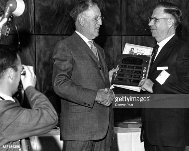 Rocky Ford Gazette Publisher Receives Award Making the sweepstakes presentation is John Mulqueen of the Dixon Paper Co Receiving the award is Ross...