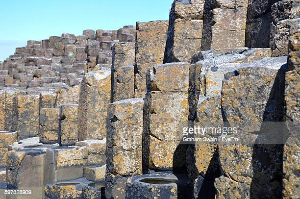 Rocky Formations At Giant Causeway Against Clear Sky