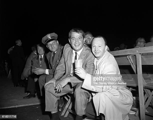 Rocky Graziano is one of the many spectators at the Carmen Basilio vs Sugar Ray Robinson middleweight title fight in Bronx New York September 23 1957