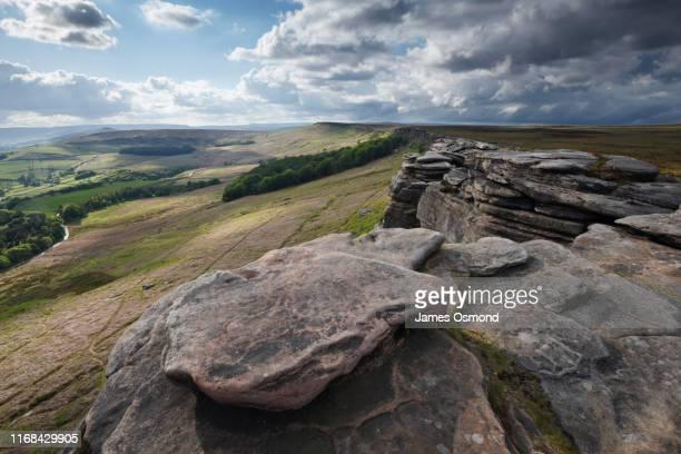 rocky gritstone edge in remote rural landscape. - at the edge of stock pictures, royalty-free photos & images