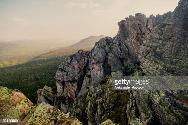 Rocky hillside over remote landscape