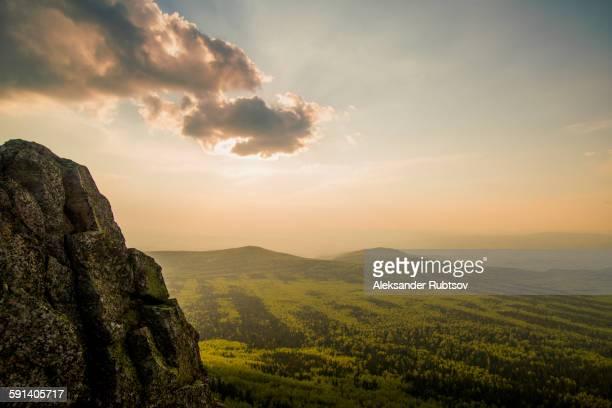 Rocky hilltop over rural landscape
