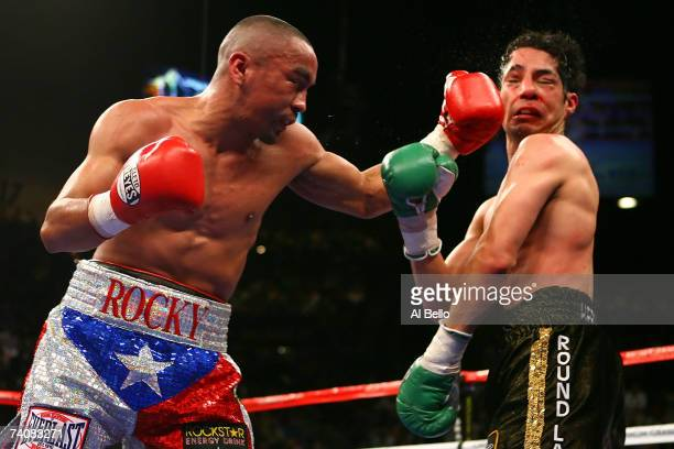 Rocky Juarez connects with a left to the face of Jose A Hernandez during their WBA featherweight championship fight at the MGM Grand Garden Arena May...