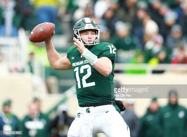 Rocky Lombardi of the Michigan State Spartans drops back to pass the ball during the game against the Purdue Boilermakers at Spartan Stadium on...