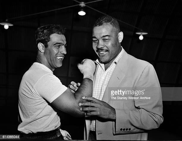 Rocky Marciano and Joe Louis talk boxing where Marciano is training for his title defense against Archie Moore at Grossingers New York September 1...
