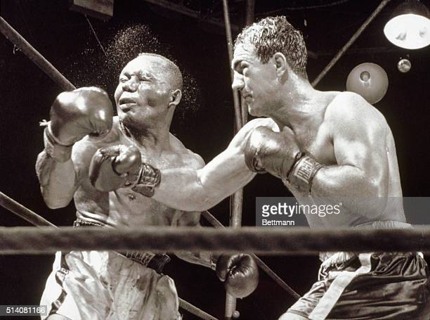 Rocky Marciano defeats Jersey Joe Walcott to win the World Heavyweight title, at Municipal Stadium in Philadelphia, Pennsylvania, September 23, 1952.