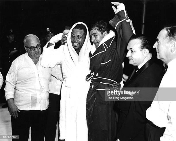 Rocky Marciano poses as he celebrates with Archie Moore after the fight at Yankee Stadium Bronx New York Rocky Marciano won the World Heavyweight...