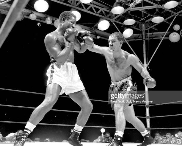 Rocky Marciano throws a right at Ezzard Charles