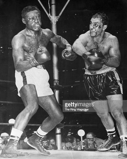 Rocky Marciano throws a right hook against Ezzard Charles during the fight at Yankee Stadium, on September 17,1954 in Bronx, New York. Rocky Marciano...