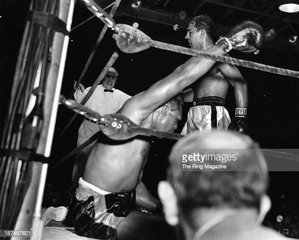 Rocky Marciano walks in the ring after knocking down Archie Moore during the fight against Rocky Marciano at Yankee Stadium on September 211955 in...